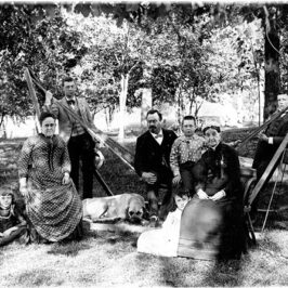 The Colonel Noble Bates Wiggins family in front of the Leland house, around 1886.